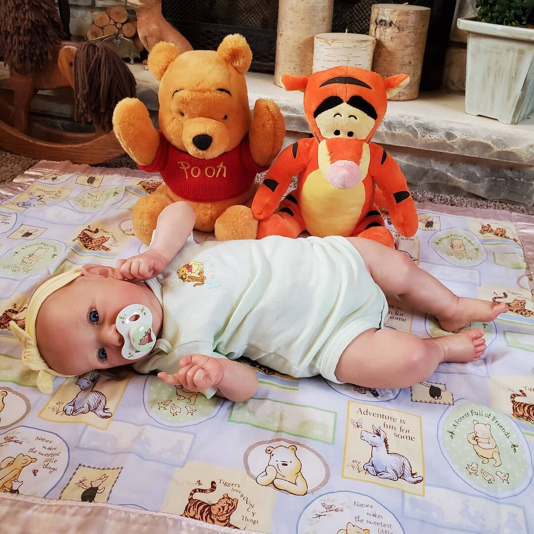 Changing cloths of a reborn baby doll